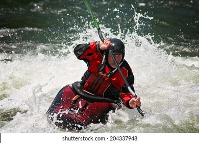 man kayaking in water
