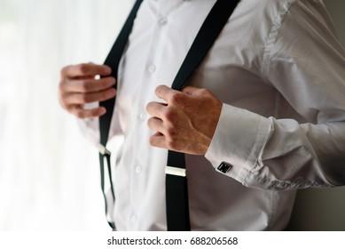 Man keeps himself for suspenders.