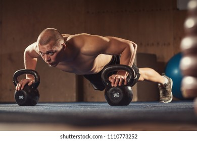 Man with kettlebell weights exercise in the fitness gym. Training fit workout. Sports functional training. Weight Lifting workout. Sports, cross, fitness concept. Strength and motivation.