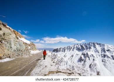 A man in Khardung la pass. Khardung la is the world's highest motorable pass.