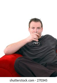 A man kicks back and enjoys an after work martini. Isolated over white