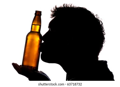 Man kissing bottle of cider silhouette
