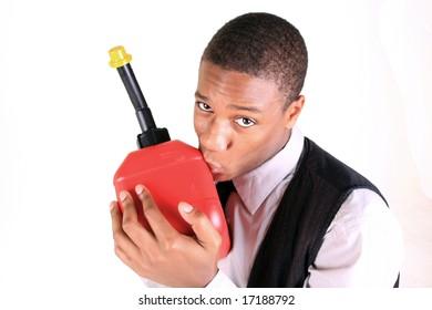 A man kissing a gan can