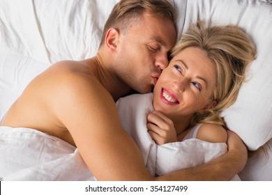 Man kissing woman on her cheek
