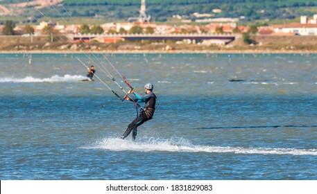 Man kitesurfing on the Ingril pond in Frontignan, in Herault, in Occitania, France