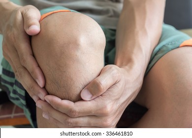 man with knee pain and feeling bad