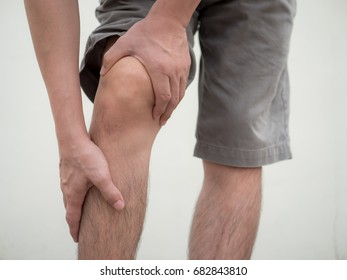 man with knee pain and feeling bad.