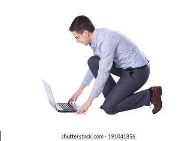 man kneeling in front of a laptop isolated on white background