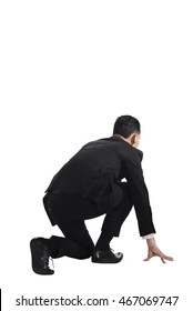 Man kneeling on start position. Businessman ready to start job.