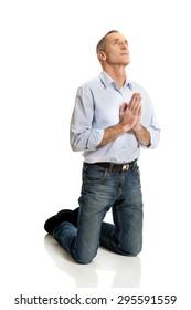Man kneeling and praying to God.