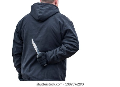 Man with the knife isolated on white background. Criminal with knife weapon hidden behind his back.