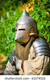 man in knight's helmet on a green background