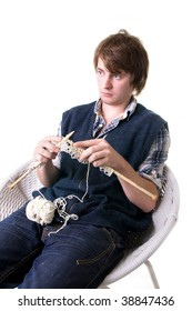 man knitting, male working on craft knit with needles isolated on white
