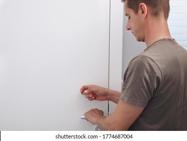 Man knocking on door before entering, Family and Personal Space concept. Family Behavior Rules during Coronavirus Lockdown