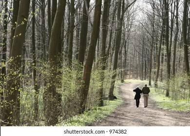 man and  ladiy in a forest