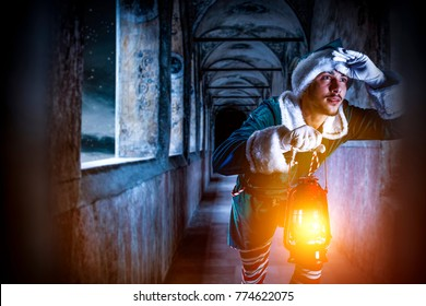 Man with lamp and dark winter night time