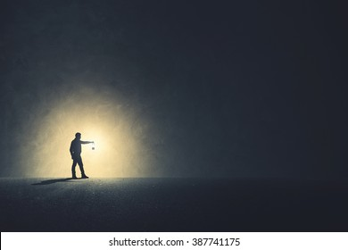 Man with lamp walking illuminating his path