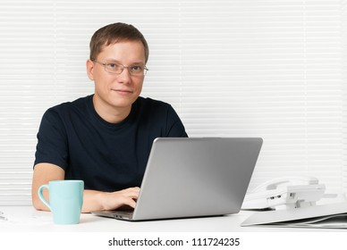 man with a laptop at the desk