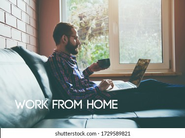 Man with laptop drinking coffee or tea and text Work from home. Home isolation and quarantine during coronavirus covid-19 pandemic.