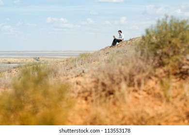 man with laptop on the hill
