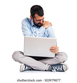 Man with laptop with shoulder pain