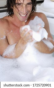 Man laughing in bubble bath