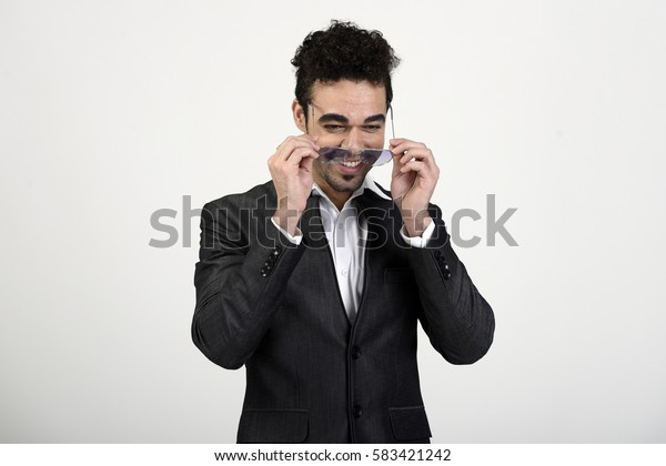 Man laughing and taking sunglasses off
