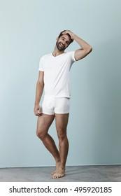 Man laughing in white underwear, portrait
