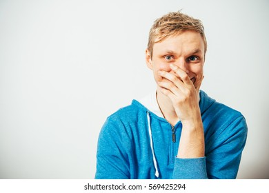 man laughs and covers her mouth
