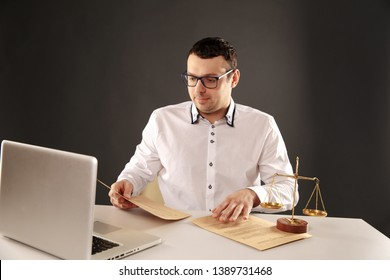 Man lawer working with contract papers. Attorney concept.