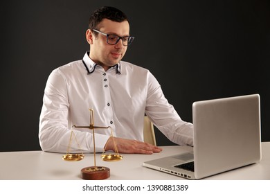 Man lawer working on a laptop. Juridical concept.