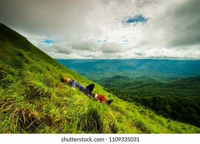 a man  lay on the ground after sumit at Doi Lung Tak, 1175 msl, Tak province Thailand
