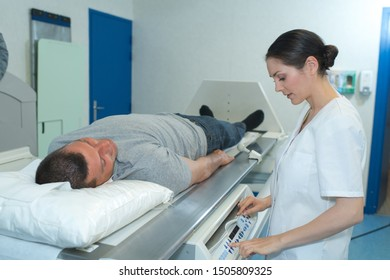 man lay on x-ray table
