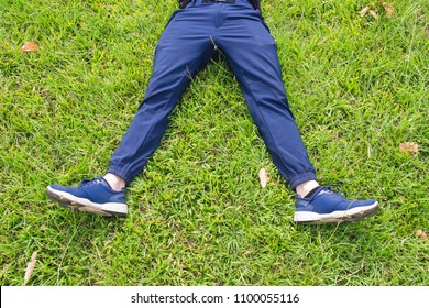 Man laying down on grass relaxing