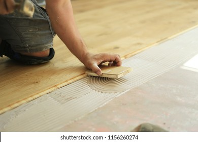 a man laying laminate on a building site