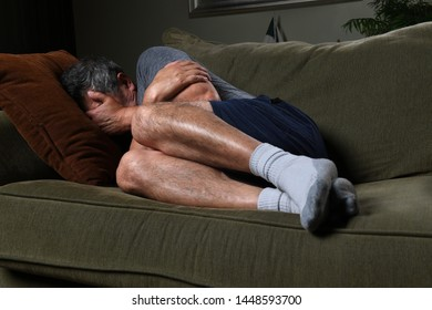 Man laying on couch suffering from depression