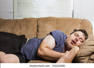 man laying on the couch taking a nap