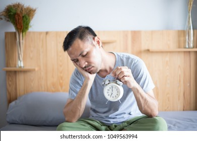 A man lazy waking up for routine daily job