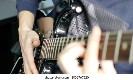 Man lead guitarist playing electrical guitar. Jazz guitarist solo practicing with guitar. Rock band practice
