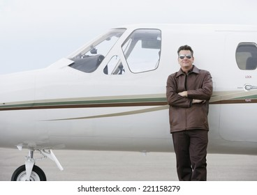 Man leaning on airplane