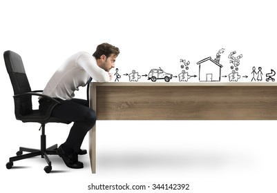 Man leaning on desk with thoughtful expression