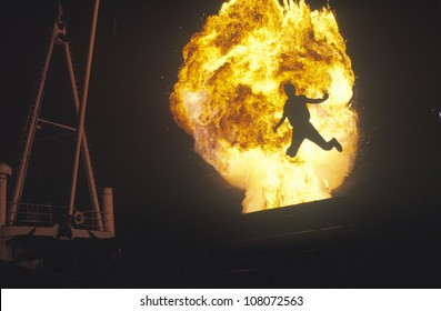 Man leaping through fireball, Miami, Florida