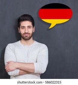 Man learn speaking german in bubble on chalkboard