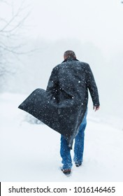 a man in a leather coat covered in snow - Shutterstock ID 1016146465