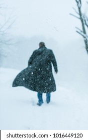 a man in a leather coat covered in snow - Shutterstock ID 1016449120