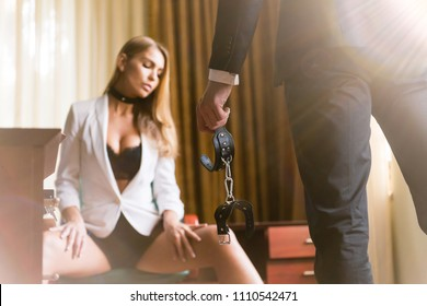 Man with leather handcuffs and woman