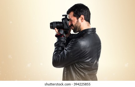 Man with leather jacket photographing