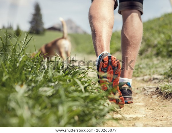 Man legs on the mountain footpath close up image
