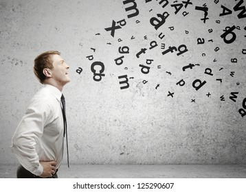 man with letters coming out of his mouth