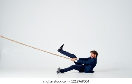 man lies on the floor and pulls the rope